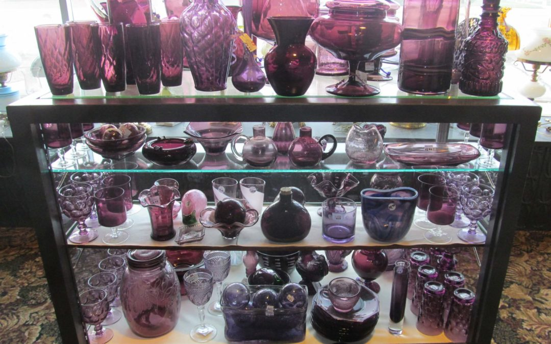 Showcase full of purple glass at Abbott Antiques